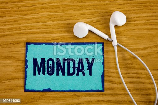 istock Writing note showing  Monday. Business photo showcasing First day of the week Back to work Weekend is over Wakeup Early written on Sticky Note Paper on wooden background Handsfree next to it. 952644090