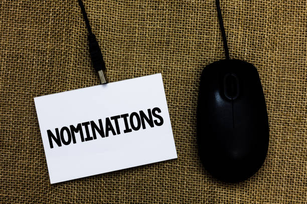 Writing note showing Nominations. Business photo showcasing Suggestions of someone or something for a job position or prize Sticky card type text convey message computer mouse jute background. stock photo
