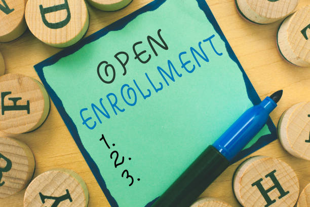writing note showing  open enrollment. business photo showcasing the yearly period when people can enroll an insurance - open enrollment stock photos and pictures