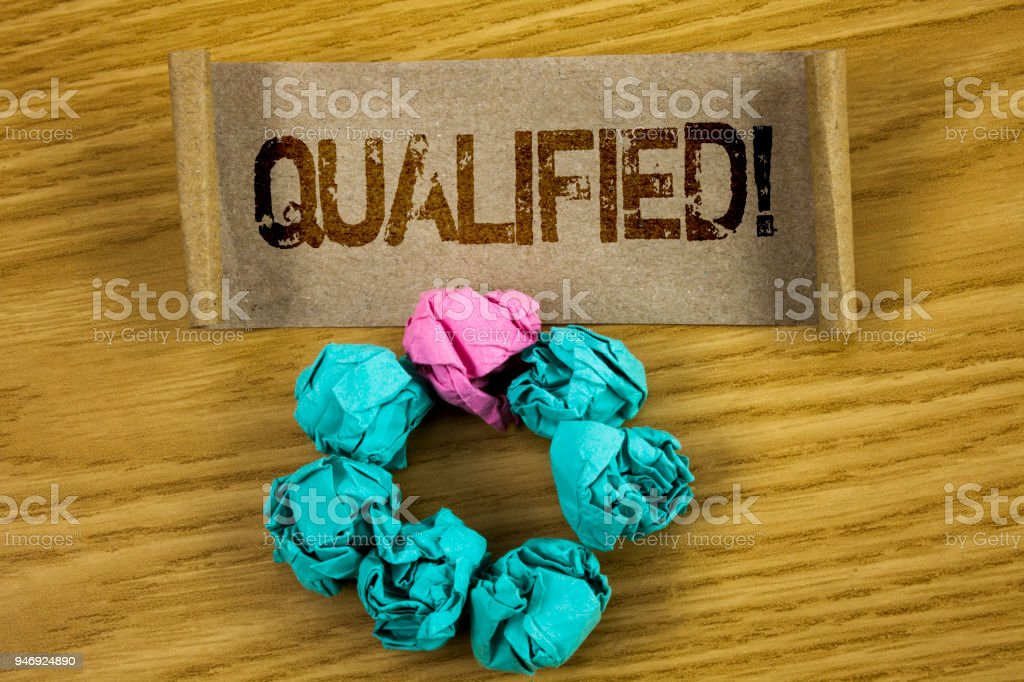 Writing note showing  Qualified Motivational Call. Business photo showcasing Certified to perform a job Competent Experienced written on Folded Cardboard Paper Piece wooden background Paper Balls stock photo