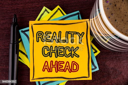 Writing note showing  Reality Check Ahead. Business photo showcasing Unveil truth knowing actuality avoid being sceptical written Sticky Note paper Wooden background Coffee Cup and Marker