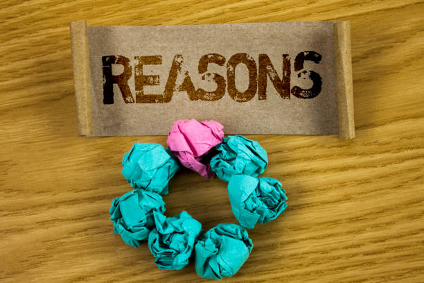 writing note showing  reasons. business photo showcasing causes explanations justifications for an action or event motivation written on folded cardboard paper piece wooden background paper balls - deductive stock pictures, royalty-free photos & images