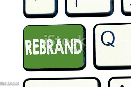 istock Writing note showing Rebrand. Business photo showcasing Change corporate image of company organization Marketing strategy 1049732854