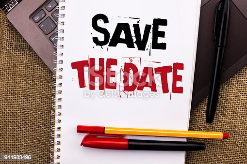 istock Writing note showing  Save The Date. Business photo showcasing Remember not to schedule anything else that time Appointment written on Notebook Book placed on Laptop with jute background Pens 944983496