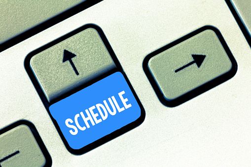 istock Writing note showing Schedule. Business photo showcasing plan for carrying out process procedure giving lists events times 1056068258