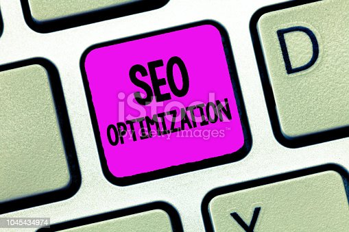 1045434476istockphoto Writing note showing Seo Optimization. Business photo showcasing process of affecting online visibility of website or page 1045434974