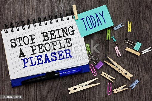 istock Writing note showing Stop Being A People Pleaser. Business photo showcasing Do what you like not things other people want Different paperclip on woody table pinch on written notepad blue pen. 1046620424