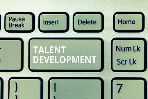 istock Writing note showing Talent Development. Business photo showcasing Building Skills Abilities Improving Potential Leader 1049736244