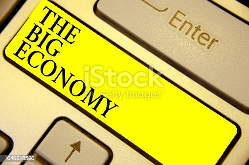 1158207931 istock photo Writing note showing The Big Economy. Business photo showcasing Global finances Worldwide Market Trade Money exchange Keyboard yellow key Intention computer computing reflection document. 1046618560