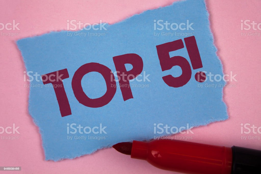 Writing note showing  Top 5 Motivational Call. Business photo showcasing The best ones Winners Most Popular Bestsellers written on Tear Blue Sticky note paper on Plain Pink background Marker. stock photo