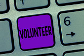 istock Writing note showing Volunteer. Business photo showcasing Person who freely offers to take part in something Charity 1056068152