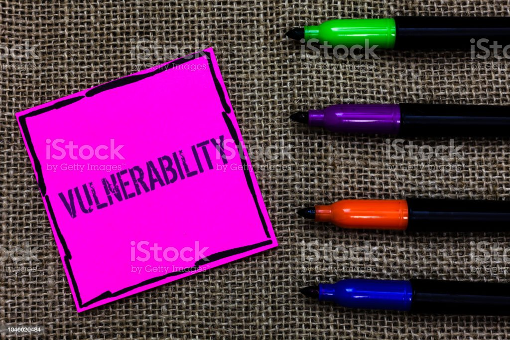 Writing note showing Vulnerability. Business photo showcasing Information susceptibility systems bug exploitation attacker Marker pens art pink paper nice mat love thought black shadow memories. stock photo