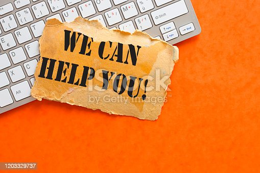 istock Writing note showing We Can Help You. Business concept 1203329737
