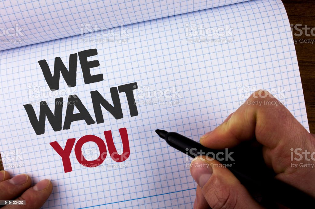Writing note showing  We Want You. Business photo showcasing Employee Help Wanted Workers Recruitment Headhunting Employment written by Man on Notebook Book holding Marker on the wooden background stock photo