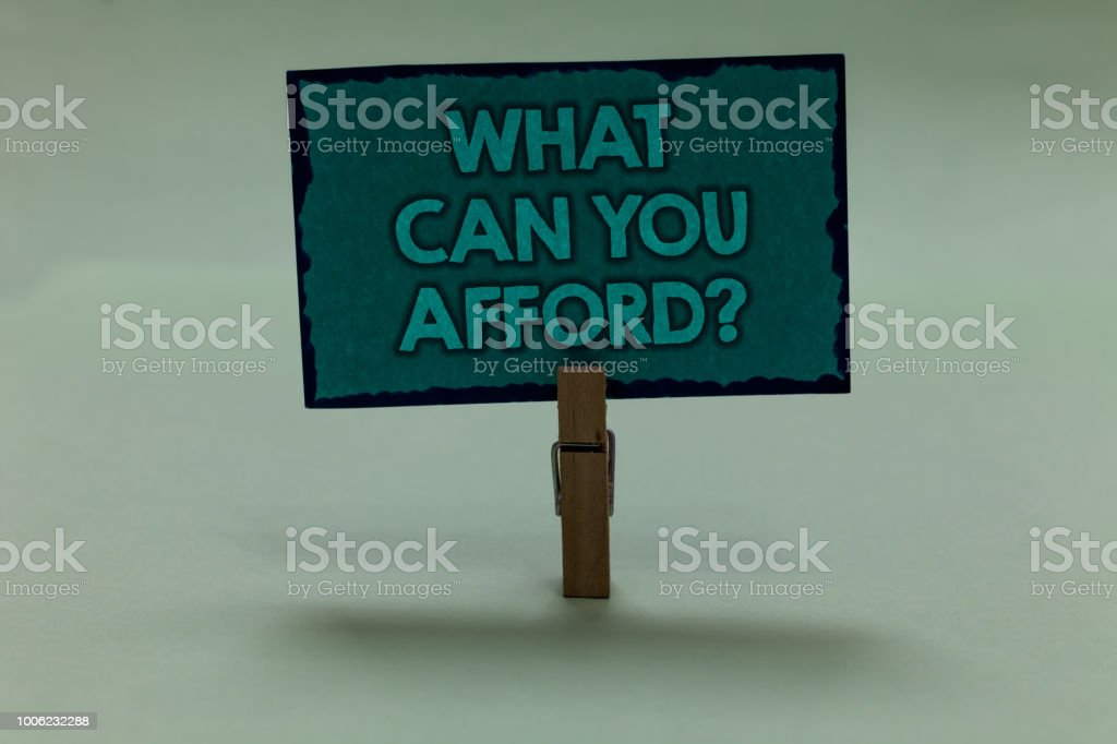Writing note showing What Can You Afford question. Business photo showcasing Give us your budget availability of money paperclip grip black lined green page with outlines grey background. stock photo