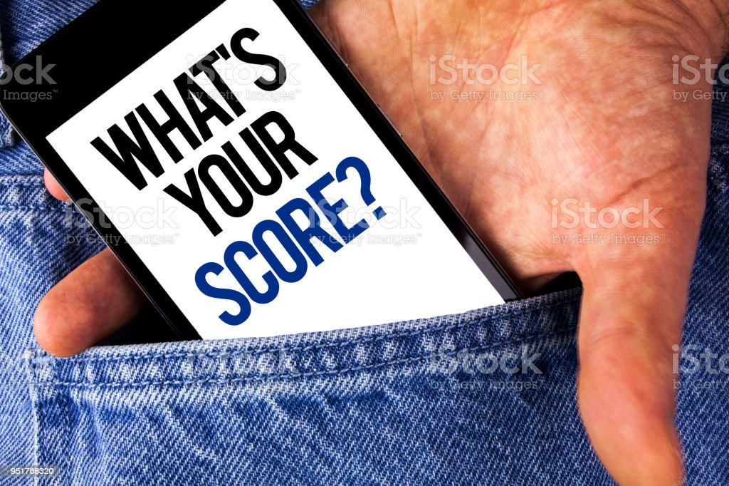 Writing note showing  What Is Your Score Question. Business photo showcasing Tell Personal Individual Rating Average Results written on Mobile phone screen holding by man on the Jeans background. stock photo
