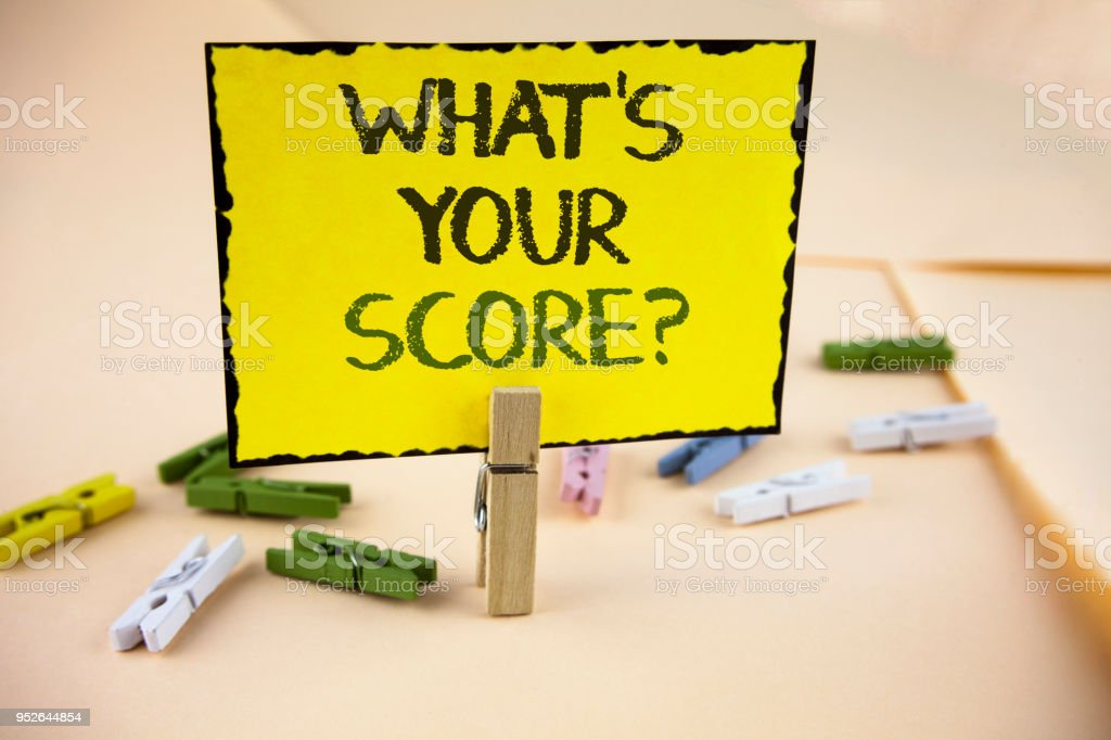 Writing note showing  What Is Your Score Question. Business photo showcasing Tell Personal Individual Rating Average Results written on Yellow Sticky Note Paper on plain background Wooden Clips. stock photo