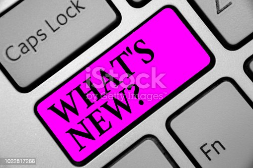 istock Writing note showing What s is New question. Business photo showcasing Asking about latest Updates Trends Happening News Keyboard purple key Intention computer computing reflection document. 1022817266
