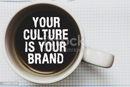 Writing note showing Your Culture Is Your Brand. Business photo showcasing Knowledge Experiences are a presentation card Coffee mug with black coffee floating some white texts on white paper