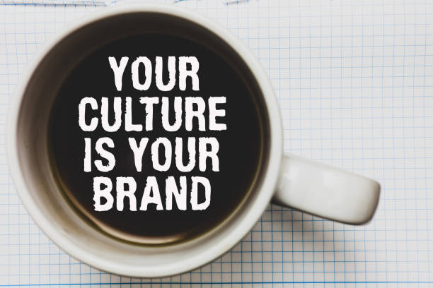 writing note showing your culture is your brand. business photo showcasing knowledge experiences are a presentation card coffee mug with black coffee floating some white texts on white paper. - cultures stock pictures, royalty-free photos & images