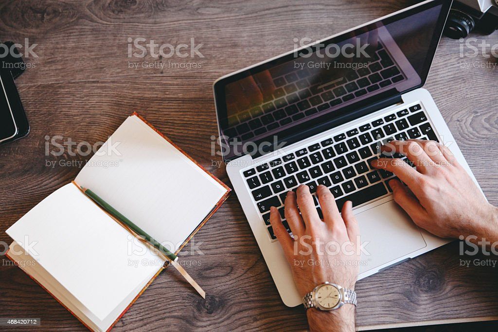 writing on a laptop