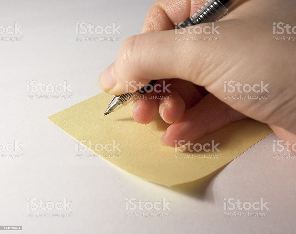 Writing on a Post-It royalty-free stock photo