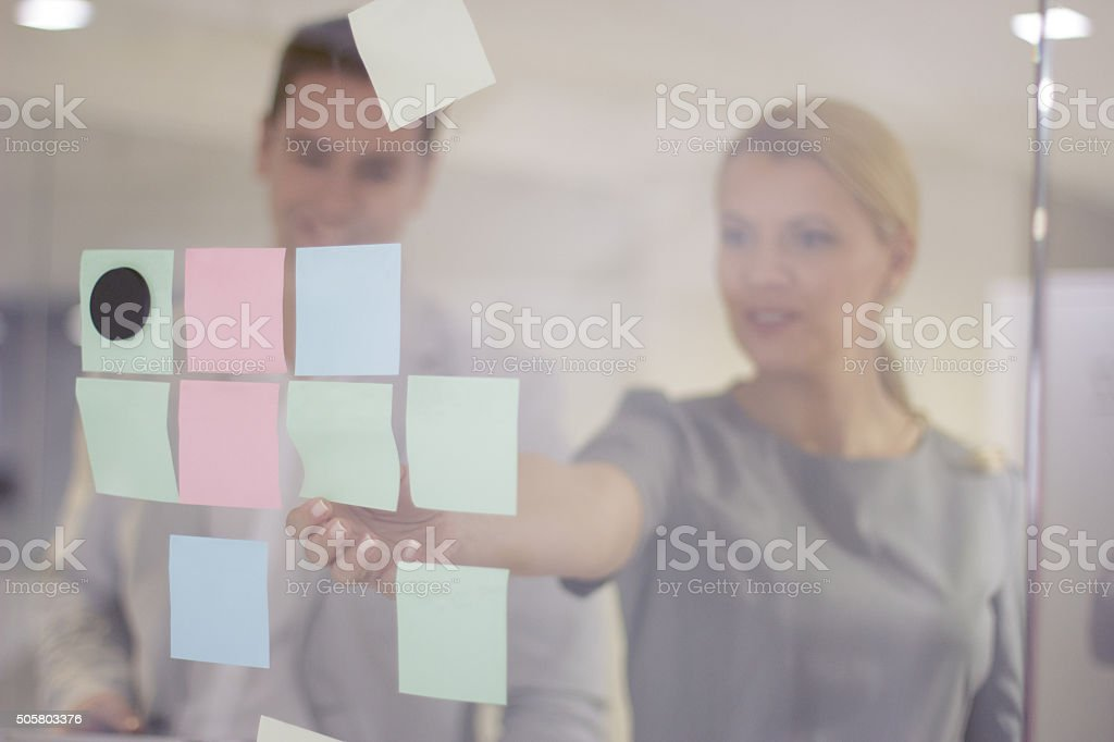 Writing on adhesive note stock photo