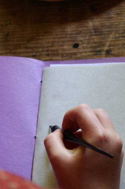 writing on blank paper with fountain pen stock photo