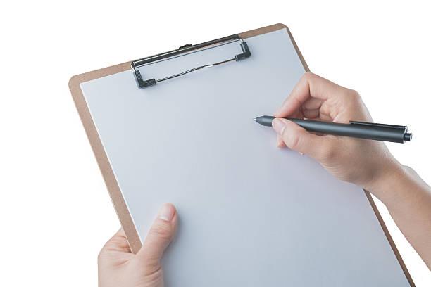 Writing on  Clipboard stock photo
