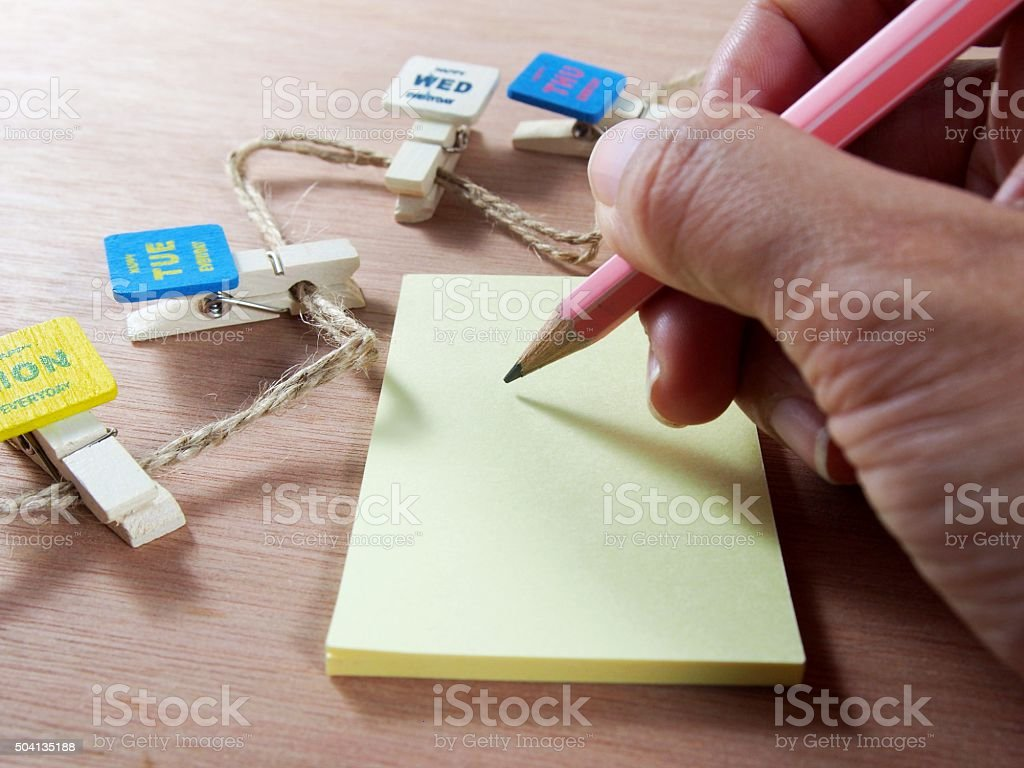 Writing on note paper with created paper clips stock photo