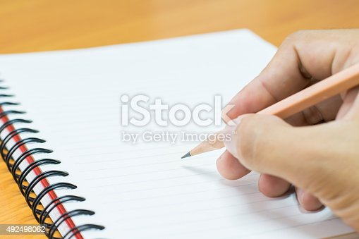 926239360 istock photo Writing on paper 492498062