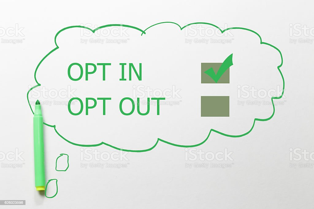 writing opt in and out, green marker on talking bubble stock photo