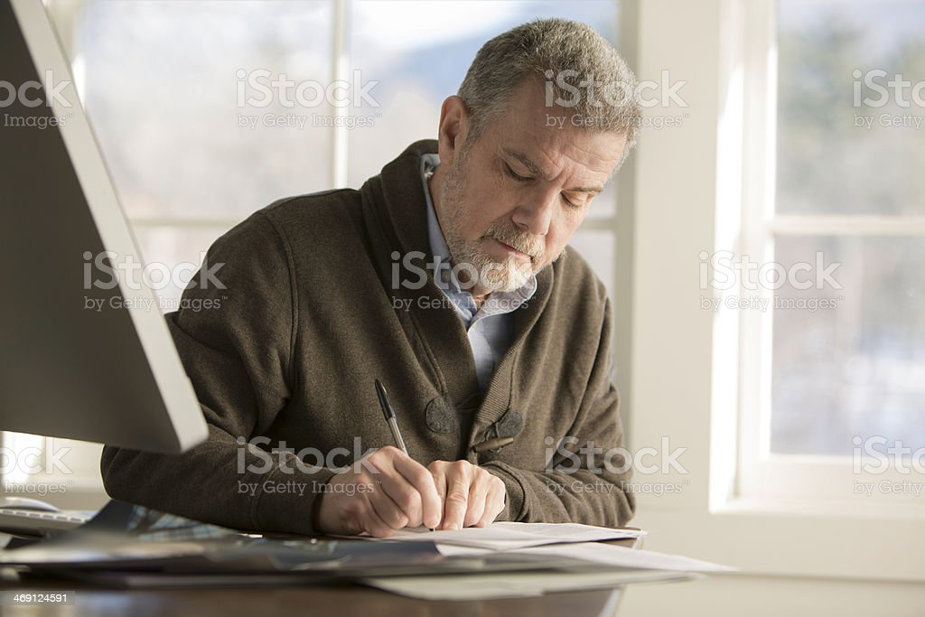 Writing or Signing Papers royalty-free stock photo