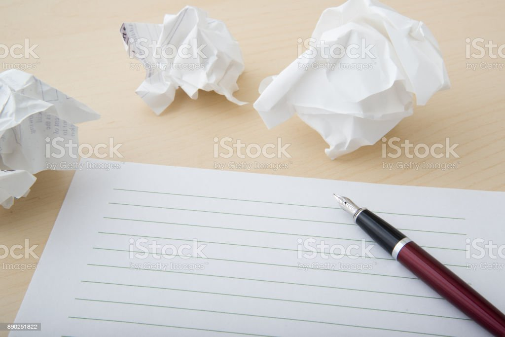 writing out ideas on paper stock photo