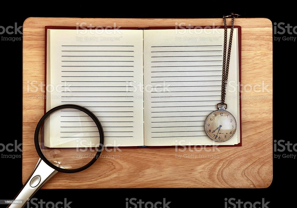Writing Pad and Loupe with Watch royalty-free stock photo