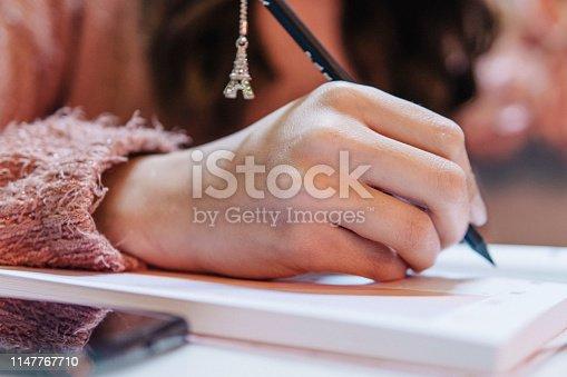 1147767708 istock photo Writing 1147767710