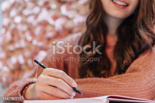 1147767708 istock photo Writing 1147767711