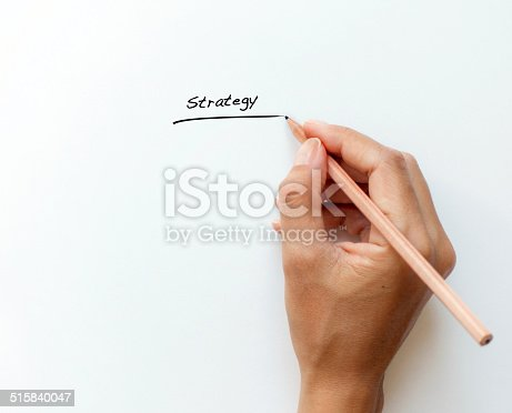 female hand writing strategy