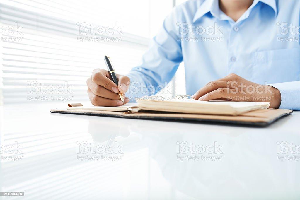 Writing student stock photo