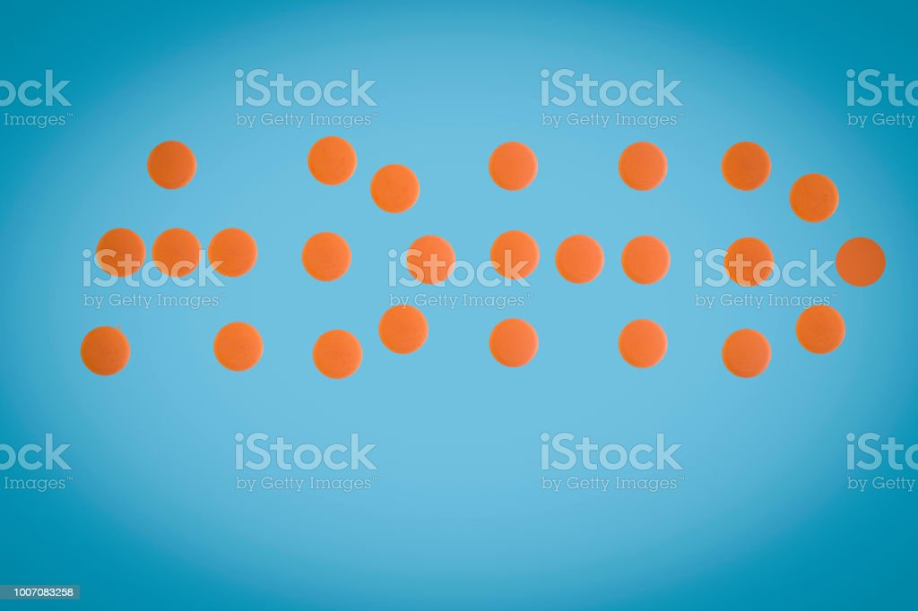 writing text caption inspiration Medical care concept written with pills drugs capsule word ADHD Attention Deficit Hyperactivity Disorder On blue isolated background stock photo