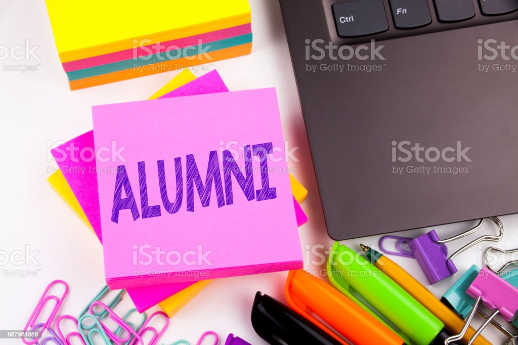 Writing text showing Alumni Former Students made in the office with surroundings such as laptop, marker, pen. Business concept for Celebration Education Ending Workshop white background copy space stock photo