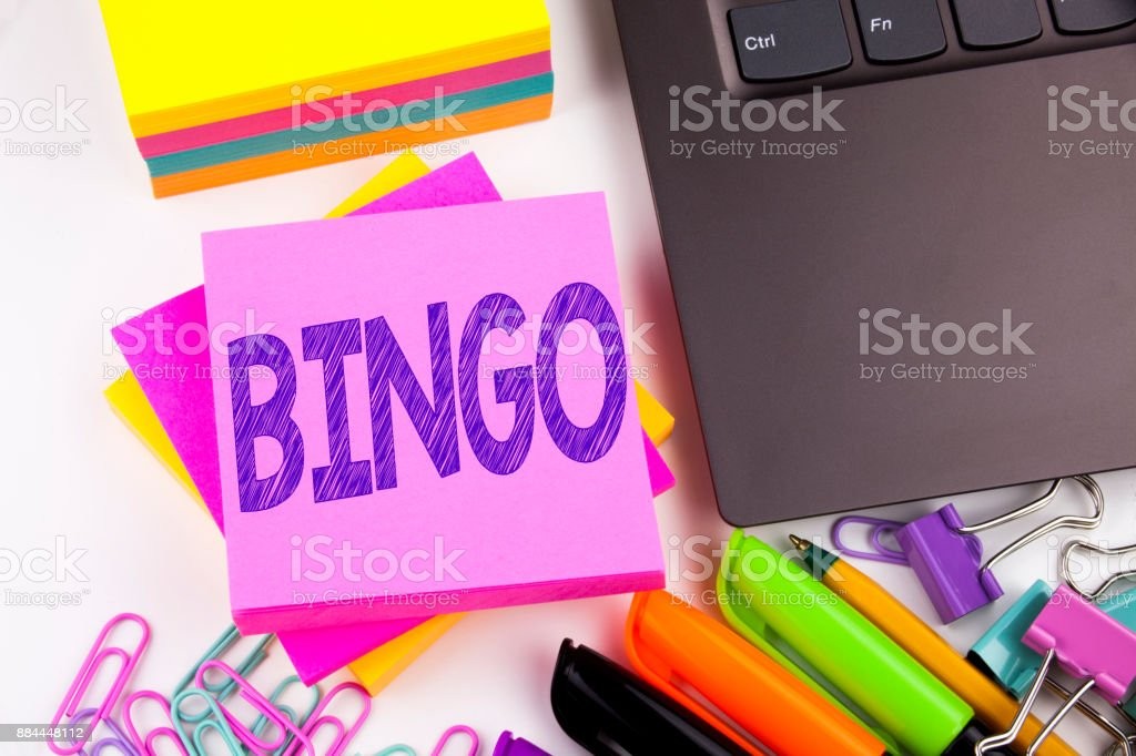 Writing text showing Bingo made in the office with surroundings such as laptop, marker, pen. Business concept for Lettering Gambling to Win Price Success Workshop white background copy space stock photo