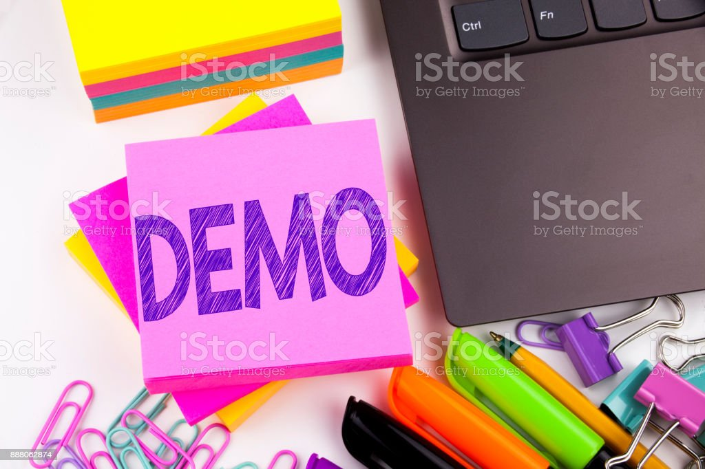 Writing text showing Demo made in the office with surroundings such as laptop, marker, pen. Business concept for Software Demonstration Workshop white background copy space stock photo