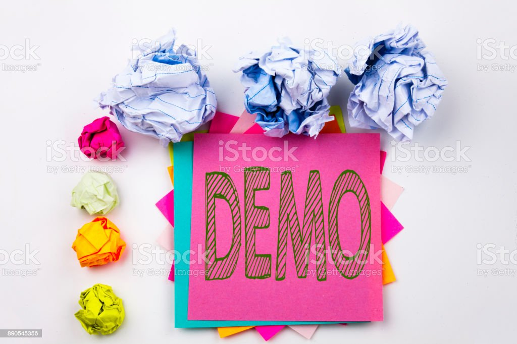 Writing text showing Demo written on sticky note in office with screw paper balls. Business concept for Software Demonstration on the white isolated background. stock photo