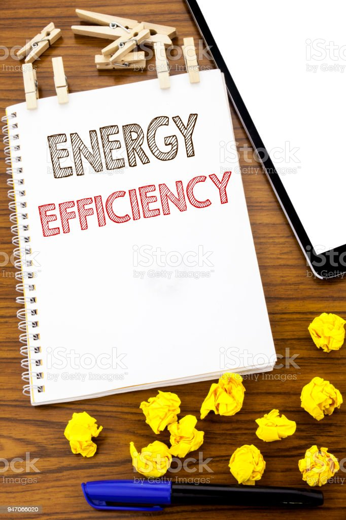 Writing text showing Energy Efficiency. Business concept for Electricity Ecology written on note paper with folded Meaning Thinking paper on the wooden background with marker and coffee stock photo