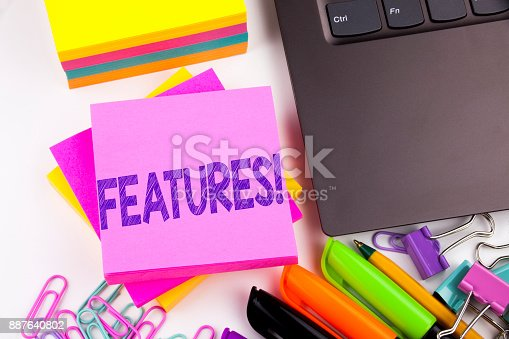 istock Writing text showing Features made in the office with surroundings such as laptop, marker, pen. Business concept for Advertisement Advertising Workshop white background copy space 887640802