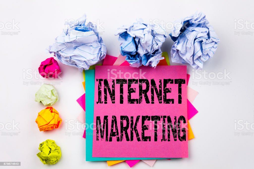 Writing text showing Internet Marketing written on sticky note in office with screw paper balls. Business concept for Technology Strategy Design on the white isolated background. stock photo