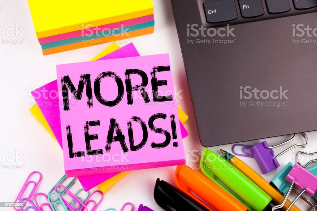 Writing text showing More Leads made in the office with surroundings such as laptop, marker, pen. Business concept for Get More Leads Consumer Marketing Workshop white background with copy space stock photo