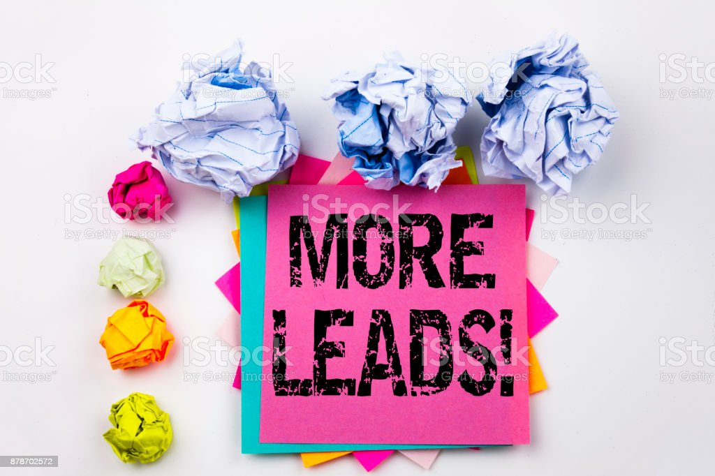 Writing text showing More Leads written on sticky note in office with screw paper balls. Business concept for Get More Leads Consumer Marketing on the white isolated background. stock photo