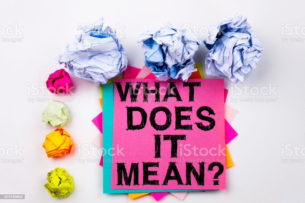 Writing text showing question What Does It Mean written on sticky note in office with screw paper balls. Business concept for asking and unknown on the white isolated background. stock photo